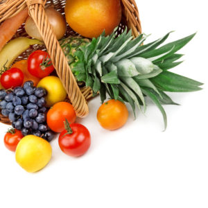 fruits and vegetables in a basket on white background